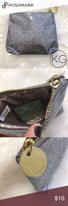 """Deux Lux Silver Glitter Zipper Pouch In excellent pre-owned condition, like new! •Great as a cosmetics or makeup bag or coin pouch •6"""" wide, 5.5"""" tall, 1"""" deep •Gold zipper and toggle - some marks on the zipper pull- see photo! •Retail $35 🚫no trades nor lowball offers🚫 Thank you for shopping in my closet! Deux Lux Bags Cosmetic Bags & Cases"""