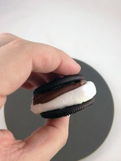 S'moreo by dudefoods: Try it with golden oreos and flat marshmallows. #Smoreo #Cookie #Oreo #dudefoods