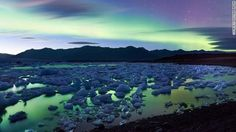 Aurora Borealis Over Icelands Jokulsarlon Glacier Lake. Also known as the Northern Lights, are light displays caused by solar winds emitted by the sun colliding with atoms of gasses in the Earth's atmosphere. One of nature's most spectacular light shows! Aurora Borealis, Glacier Lake, Iceland Glacier, Our Planet Earth, See The Northern Lights, New Travel, Travel Deals, Travel Guide, Travel Stuff