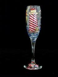 Lively Lighthouses Design - Hand Painted - Flute - 6 oz. by BELLISSIMO!. $34.02. Hand Painted - Flute - 6 oz. - 8.75 inches tall Light up your next party with glassware elaborately hand painted with an assortment of Lively Lighthouses. These fantasy lighthouses are gaily colored in bright red, green and blue stripes. With no two exactly alike, they are situated by the sea surrounded by multi-colored sailboats bobbing about on a gorgeous sunny day.