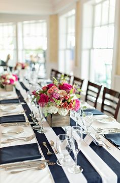 Nautical Wedding Decor with Striped Runners and Colorful Flowers | Shoreshotz Photography on @myhotelwedding via @aislesociety