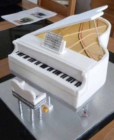 Stunning White Piano Cake - For all your cake decorating supplies, please visit craftcompany.co.uk