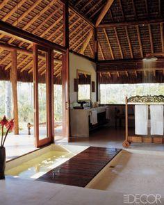 master bath of designer Charlene de Ganay: Brazilian  Balinese towel rack + sunken tub + angelim wood deck = incredible bath room design