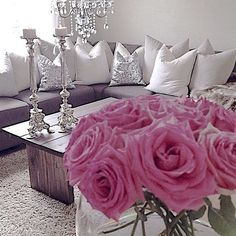 The lift grey couch with silver, white, and cream pillows. Add a pop of color (floweres, vase, diamond like marbles, etc