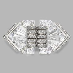 Diamond and rock crystal double-clip/brooch, Maison Herz, Designed by Suzanne Belperron, circa 1935
