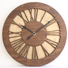 """The Classic Vintage is a Large Handmade Roman Numeral Wall Clock that is designed to be a statement piece in your living room. It displays carefully hand carved numerals on the hand painted """"golden"""" background. Don't follow the old habits, challenge accepted thinking and make the oversized handmade wall clocks from Peak Art the new fashion. Only at Peak Art you can find the true uniqueness in this niche and you can stand out from the crowd by owning something so unique"""