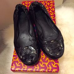Tory Burch Reva Flats in Black Patent Leather *Extremely Used.* SOLD AS IS. These Tory Burch flats were my favorite shoes for 2 yrs. Selling for less as they are extremely used. Significant signs of wear!!!! Authentic purchased from Bloomies, but condition is reflected in the price. Original box included. Still hope they can go to a good home tho! Tory Burch Shoes Flats & Loafers