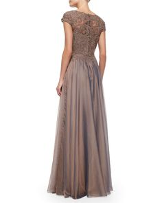 La Femme chiffon gown with beaded lace gown. Bateau neckline with sweetheart illusion. Cap sleeves. Softly ruffled skirt. Concealed back zip. Polyester; self lining. Spot clean. Imported.