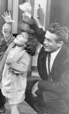 """James Dean plays with a little girl on the set of Rebel Without A Cause, 1955. """