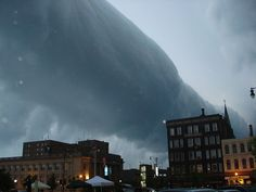 Roll cloud under thunderstorms, sign of the gust front.  Datum     Taken on June 1st, 2007 in downtown Racine, WI.