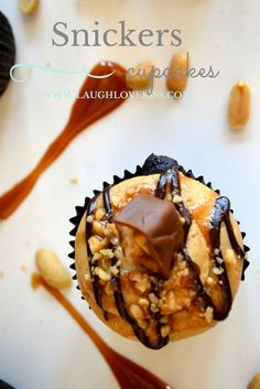 Snickers Cupcakes at www.laughlovekiss.com