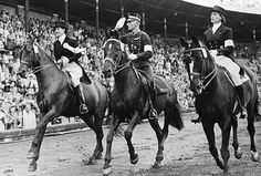Stockholm June 1956, Equestrian Games of the XVI Olympiad. Individual dressage: Lis HARTEL-HOLST of Denmark with Jubilee, 2nd, Henri SAINT CYR of Sweden with July, 1st, and Liselott LINSENHOFF-SCHINDLING of Germany with Adular, 3rd, ride past the Stadium stand. Credit: IOC Olympic Museum Collections