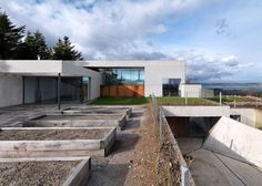 Stormy Castle house pairs concrete and glass with traditional stone