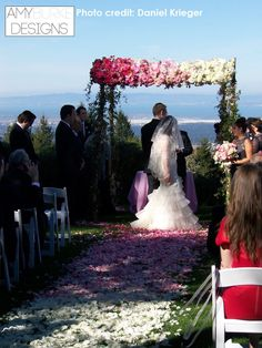 White to pink ombre rose petal runner with pink to white roses across the chuppah. #ceremony @smoothdude Location Thomas Fogarty Winery