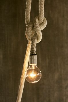 Love the rustic feel of this rope pendant.