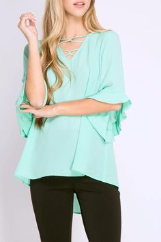 This mint shirt features half sleeves with ruffles criss cross details on the neckline and a flowy design. Pair this with your favorite pants and you're ready to go! Ruffle Sleeve Top by She  Sky. Clothing - Tops - Blouses & Shirts West Virginia