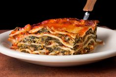 Note: This easy spinach lasagna recipe is made with layers of creamy ricotta and spinach filling, tomato sauce, and mozzarella cheese.