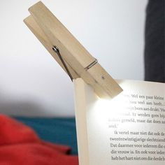 This Clothespin Clip Light is a beautiful innovation that converts a simple clothespin into a pocket flashlight or hands-free portable reading lamp that you can clip on anywhere. Korean designer Sungho Lee created it to be an LED Pin. Gadgets And Gizmos, Cool Gadgets, Computer Gadgets, Geeks, Book Light Clip, Design3000, Light Clips, Led Licht, Luz Led