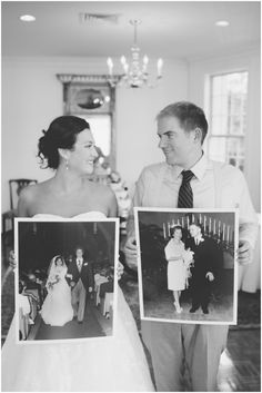 bride and groom holding parents wedding pictures
