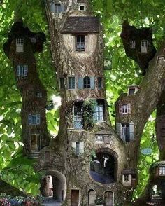 Amazing..........It looks like an entire fairy condominium.........LOVE this, such a cute addition to a front yard garden!!!