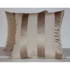 These beautiful decorative pillows are made from a woven taupe stripe and checkered pattern. They are finished and backed with a coordinating solid taupe fabric.