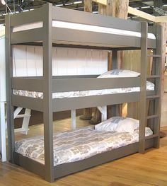 This triplet bunk would take up very little space in our girls room!