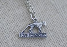 Tiny Thylacine Necklace by ~foowahu-etsy on deviantART