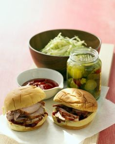 This recipe uses lean tenderloins in place of shoulder for a lighter oven-roasted pork sandwich. Brush the meat with quick homemade barbecue sauce and serve on potato rolls with sweet and tangy slaw.
