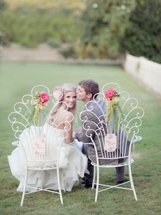 bride and groom in decorated chairs.