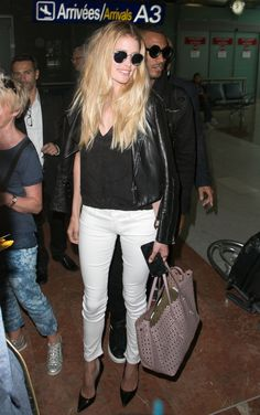 Kroes proves you can look instantly chic upon arrival just by throwing a leather jacket on your shoulders.   - MarieClaire.com