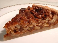 Caramel Nut Tart ~ Do you love nuts?  This nut tart recipe combines walnuts, pecans, and almonds, in a caramel filling, served in a buttery crust.  ~ SimplyRecipes.com