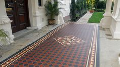 Traditional black and red checkerboard, with a cognac dogtooth border supplied as loose tiles for a grand portico. The clients were presented with a collection of options for the central motif as part of the design consultation process. The tiler, Paul Spanswick, also fitted the York stone thresholds and prepared the area before installation.  Design & Supply - www.londonmosaic.com  Installation - www.ceramicandstone.co.uk