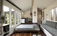 slide out bed 20 Smart Micro House Design Ideas That Maximize Space