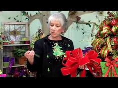 http://www.LadybugWreaths.com  Nancy Alexander filmed a FREE, video on bow making for her friends and students!  Learn to make a large Christmas topper for your tree, how to make a deco mesh bow, and how to make a full bow using more narrow ribbon.    Nancy's bow-making is known world-wide as she makes her bows in a very simple way that she design...