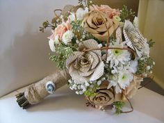 This bride was born crafty! She created beautiful paper flowers and let us create bouquet pieces out of them. It was so much fun working w...
