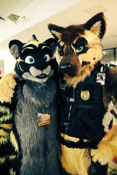 """fursuitpursuits: """"RT @UltraKana: Picture of @RichardNightfox and me during @eurofurence #EF21 Felt so safe with a police dog around! #fursuitfriday http://t.co/6OXP6D8lLk (Source) """""""