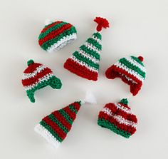 these tiny hats are adorable .....Free pattern ;)