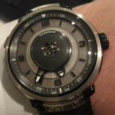 Frankly wonderful Faberge DTZ dual timezone watch, jumping hour numeral is only visible magnified through central window when looking straight on.