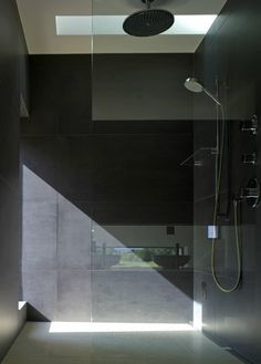 clean shower with stone tile and light