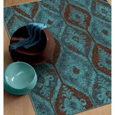 Our Melodic Majestically Aqua area rug showcases a delightful vintage style with a dramatic pattern combined with a beautiful blend of vibrant teal and rich brown.  The fashionable over-dyed look is one of today's hottest trends for any home décor.