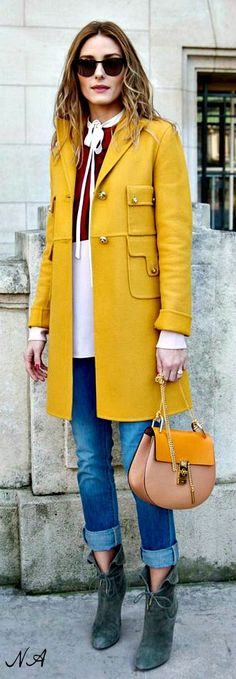 Can't go wrong with midlength waves, a bright trench, skinny jeans, and booties for Fall