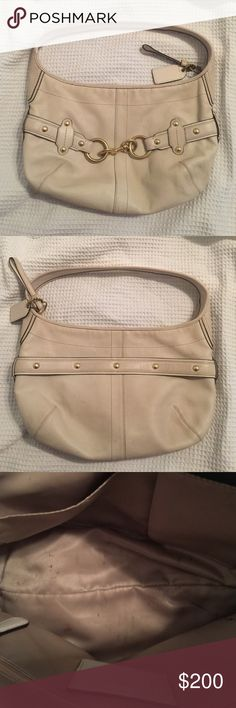 Cream Coach Purse Cream coach purse. Used but in good condition. Few signs of wear. Smal smuggled on the back, bottom and inside the bag. Buckles are gold. Coach Bags Satchels