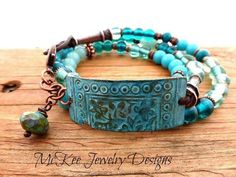Blue, teal and turquoise glass, copper metal and leather wrap bracelet. Bohemian jewelry.