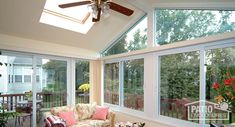 Searching for sunroom inspiration? Take a look at this White Four Season vinyl sunroom with glass roof panels in gable roof, glass wings and solid knee wall. #sunroom #homeimprovement