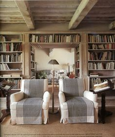 bookshelves over door, integrated with beam ceiling, etc, club chairs nice too