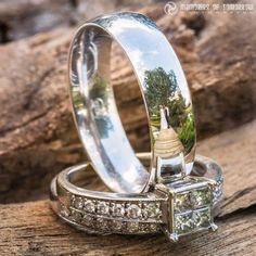 Here's a neat way to take your photos of wedding rings to the next level: include the couple in the reflections. Wedding photographer Peter Adams-Shawn of