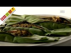 Rice Packets In Banana Leaf - Cooked rice & whole moong mixed with pickle masala, wrapped in banana leaves & pan fried.