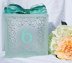 A personal favorite from my Etsy shop https://www.etsy.com/listing/221753632/wedding-table-number-marker-glass-block