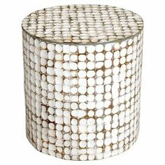 "Handmade wood end table with a mosaic-style coconut shell overlay and white patina finish. Product: End tableConstruction Material: Coconut shells and solid woodColor: White patinaFeatures: HandcraftedCoconut shells are individually laminatedDimensions: 16"" H x 16"" Diameter"