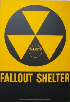 Fallout Shelter sign. I remember bomb drills in grade school. Can you believe that we believed the 'experts' that all we had to do was get under a desk and cover our heads ?????